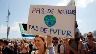 Environmental activists gather to urge world leaders to take action against climate change in Marseille